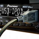 Pioneer car radio with 'USB iPod' on display and USB connection cable plugged in