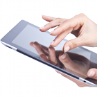 female hands, holding iPad, touching screen