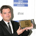 www.radioiloveit.com | talkSPORT PD Moz Dee with his Sony Radio Academy Award for Station Programmer of the Year 2011 (photo: talkSPORT)
