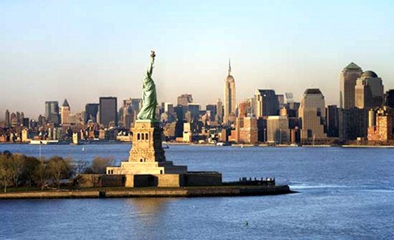 Statue of Liberty, New York City skyline at day