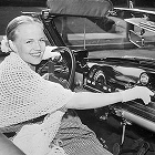young woman, listening car radio, vintage car radio