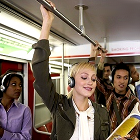 young people wearing headphones, subway, public transportation