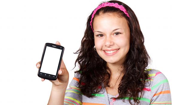 young woman holding smartphone, teenage girl holding mobile
