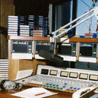 Z100 radio studio, PR&E (Pacific Recorders & Engineering) broadcast mixer, Shure SM7 microphone, ITC cart machines and Audiopak NAB cartridges